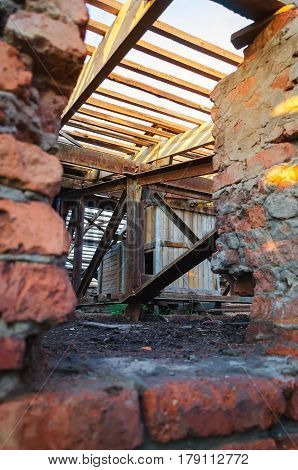Interior of abandoned administrative building. Interior ruins of industrial factory. Old concrete ruins corridor with garbage and mud ruined walls of unfinished building