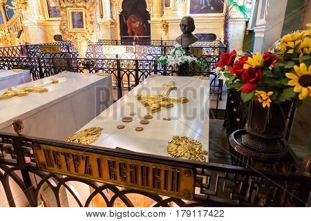 SAINT PETERSBURG RUSSIA - AUGUST 9 2014: Tomb of Peter the Great in the Peter and Paul cathedral with tombstone and orthodox cross