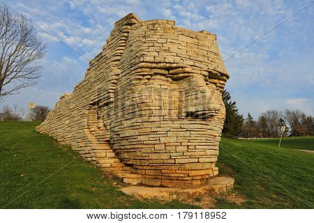 DUBLIN, OHIO - MARCH 25, 2017:  Made of limestone slabs, this sculpture depicts The Wyandote Indian chief Leatherlips.  This 12 foot high statue is a popular attraction in Dublin, Ohio.