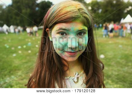 Teenager Girl With Painted Face On Holi Colour Fest