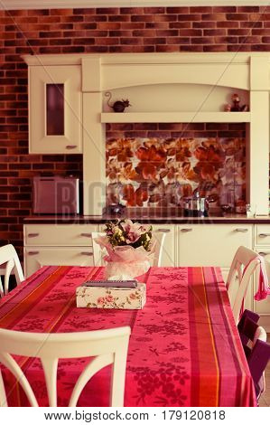 Red Kitchen Interior With Table Cloth Chairs