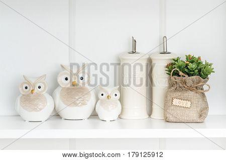 Decorative White Owls On White Shelf