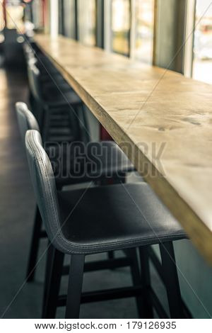 Empty bar and gray soft chairs in a row