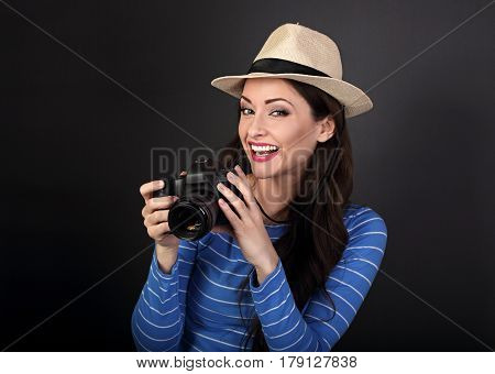 Excited Young Female Professional Photograph In Summer Hat Holding Photo Camera And Looking Happy On
