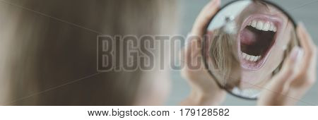 Mirror reflection of a shouting girl, panoramic