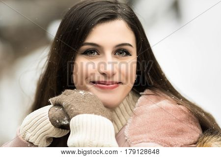 One caucasian high school girl posing for senior pictures