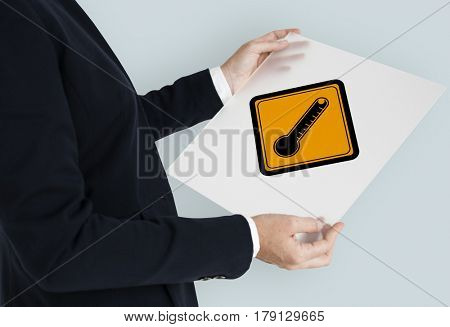 Studio Shoot Holding Banner with Termometer Attention Sign