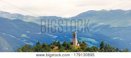 Medieval church on top of the hill Italian Alps
