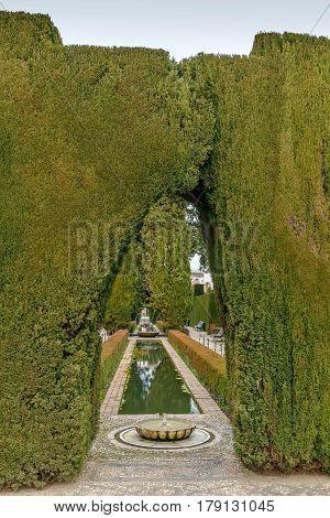 Fountain and pool in Generalife garden Granada Spain