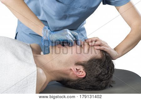 Physiotheraphist is doing a sinus massage theraphy.