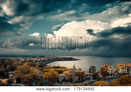 dramatic clouds over the sea and peninsula in sozopol, bulgaria