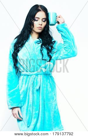 Sexy Girl Posing In Turquoise Velour Bathrobe With Cup