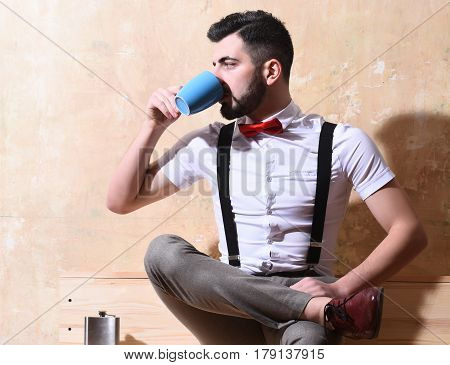 Bearded Man Drinking Coffee, Tea From Cup With Serious Face