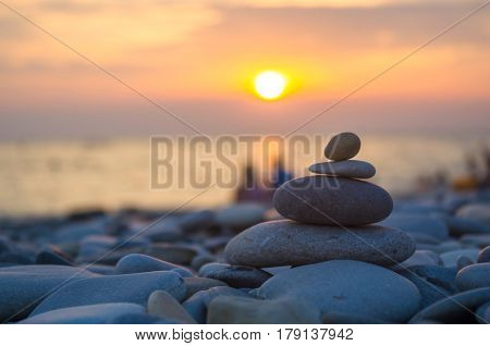 A Couple And Stack Of Zen Stones On Beach