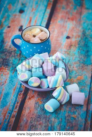 Marshmallow On Blue Table And Cup Of Coffee