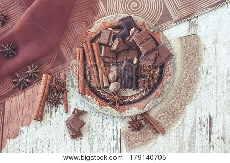 Chocolate And Spices On Decorated Copper Plate