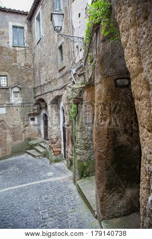 Detail of an alley in the village of Calcata built on tuff.