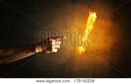 Hands reaching each other and fire glowing exclamation mark