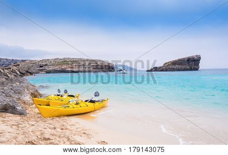 Traditional yellow traveling boat on Comino beach - Blue Lagoon island of Malta