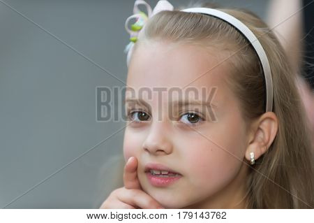 Small Baby Girl With Adorable Face Winking Outdoor
