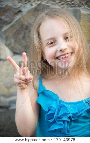 Small Baby Smiling Girl With Long Blonde Hair Outdoor