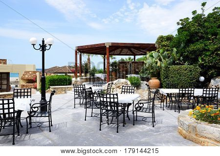 The outdoor restaurant at luxury hotel Crete Greece