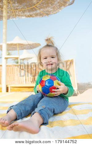 Small Baby Boy With Happy Face Sunny Summer With Ball