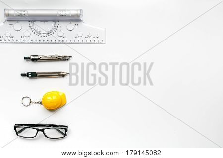 Architects workplace with constructor tools and glasses on white table background top view mock up