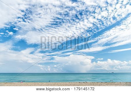 Sea Water On Sandy Beach And Blue Sky In Miami