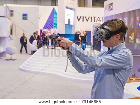 LAS VEGAS - JAN 08 : Virtual reality demonstration at The Vivitar booth at the CES show in Las Vegas on January 08 2017 CES is the world's leading consumer-electronics show.