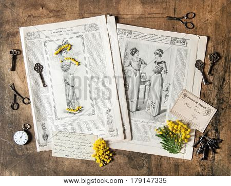 Nostalgic background with antique fashion magazine. Vintage accessories and open book with old letters