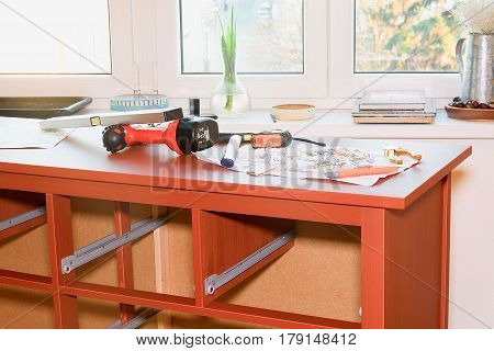 Hustopece, Czech Republic - March 26, 2017: Image shows assembling  furniture.  Assembling chest of drawers (dresser). Set of tools and fasteners for furniture assembling.