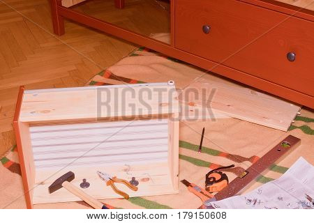 Assembling  Furniture.  Assembling Chest Of Drawers (dresser). Set Of Tools And Fasteners For Furnit