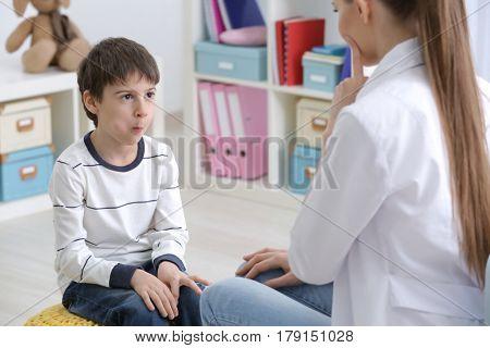 Cute little boy at speech therapist office