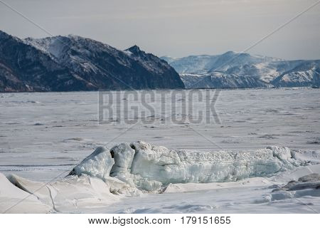 Ice on the Sea of Okhotsk against the background of mountains Magadan region