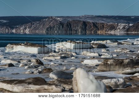 Ice floe on the Sea of Okhotsk against the background of mountains Magadan region