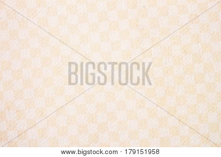 Texture of paper in a single-colored small cell of warm beige-cream shades. Background , backdrop, substrate, composition use for design, copy space for text or image.