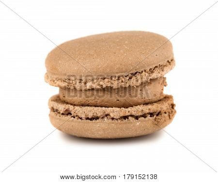Single brown french macaroon cookie on white background