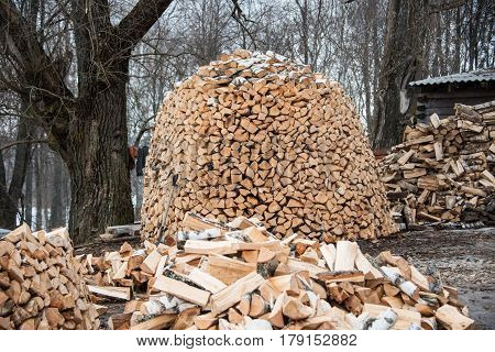 Pile of firewood. Firewood, prepared for winter