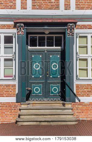 Decorated Door Of A Historical House In Stade