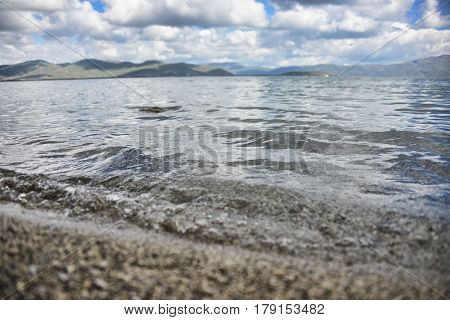 Wave rolling on the shore on Lake Sevan
