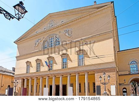 The facade of Parma Opera House named Teatro Regio or New Ducal Theater faces the Garibaldi Street Italy.