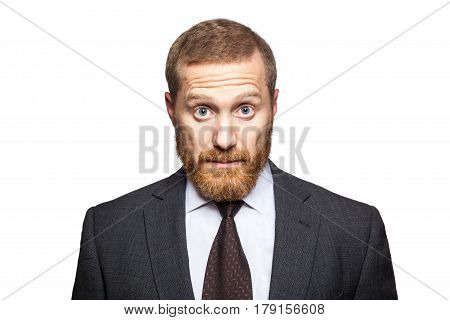 Shocked surprised businessman looking at camera with big eyes. isolated on white looking at camera.
