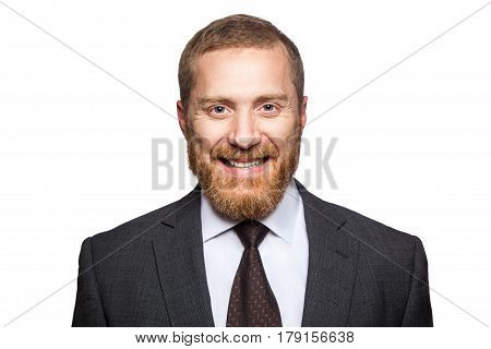 Happy smilely businessman looking at camera with toothy smile. isolated on white looking at camera.