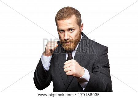 Confident businessman ready for fight and boxing. looking at camera studio shot isolated on white background.