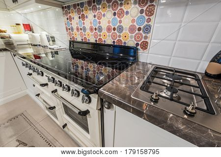 Kitchen interior with modern appliances ovengas stoveinduction cooktop