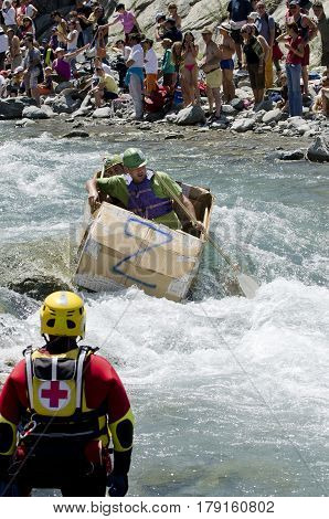Cesana Torinese, Italy - July 3, 2011: The Carton Rapid Race is a bizarre amateur race on the Dora River. The race is a timed descent into cardboard river boats built locally.