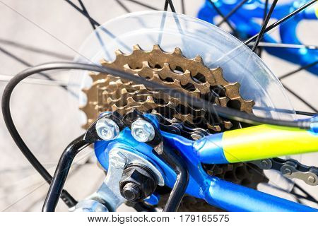 Closeup of bicycle gears chain and cables neon yellow and blue bike