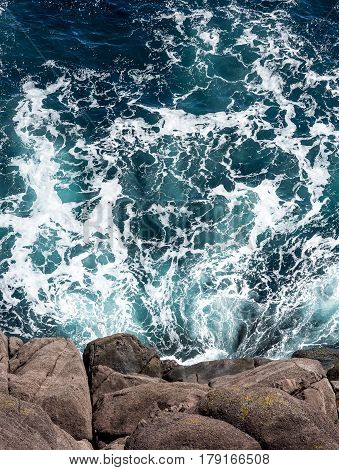 Overhead View Of Atlantic Ocean Against Rocky Cliff