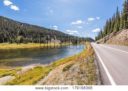 Poudre Lake in the fall in Rocky Mountains in Colorado with road